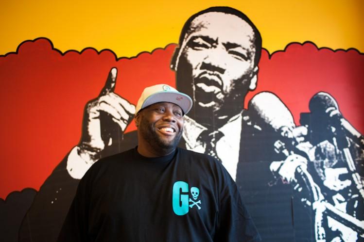 Killer Mike portraits in his barbershop graffiti swag shop