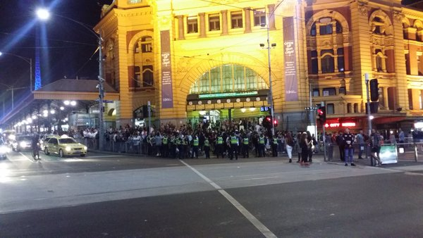 Police block off access to Flinders Street Station.