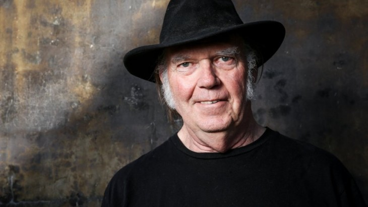 "FILE - In this May 18, 2016 file photo, Neil Young poses for a portrait in Calabasas, Calif.  Young will be Dan Rather's first guest for the new edition of Rather's series, ""The Big Interview."" Young will be featured on the Sept. 13 episode airing at 8 p.m. EDT on AXS TV. (Photo by Rich Fury/Invision/AP, File)"